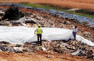 Daily Landfill Covers Deployed Manually or by Hand